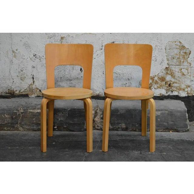Pair of early No. 66 chairs by Alvar Aalto for Artek in beechwood