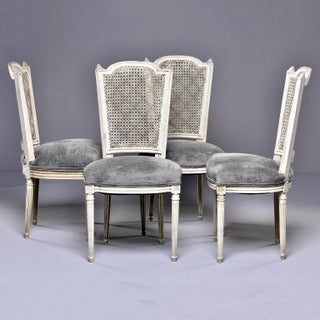 Set of Four French Painted Chairs With Upholstered Seats and Caned Backs Preview