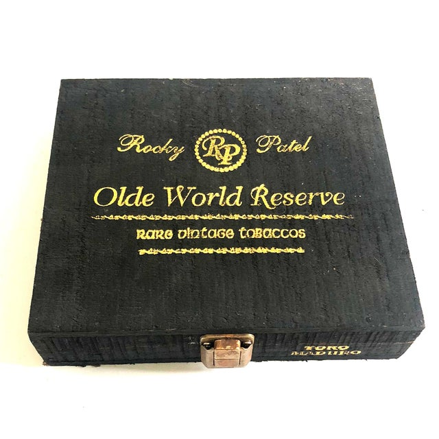 "Vintage ""Olde World Reserve"" wooden cigar box. Black with gold lettering and brass hardware. From Honduras. 8.75"" x 7.5"" x..."