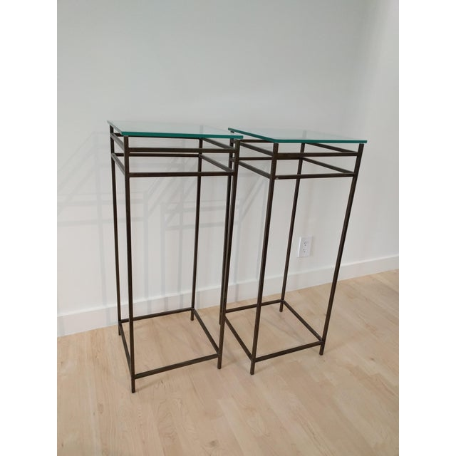 A pair of contemporary / modern metal & glass pedestal plant stands. The body is a heavy metal and painted brown with...