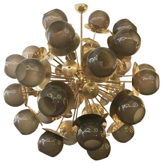 Italian Sputnik chandelier with smoky Murano globes, mounted on natural brass frame / Designed by Fabio Bergomi for Fabio...