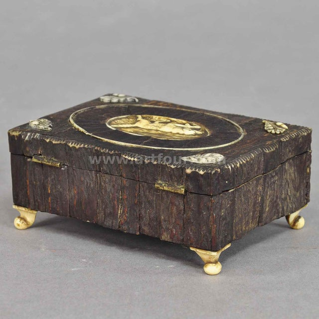a marvelous antique rustic casket. made of wood, veneered with antler horn pieces. on top a horn plaque with staghound...