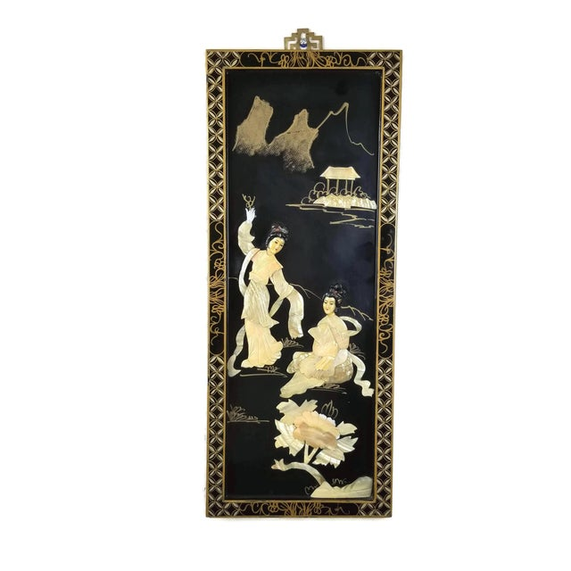 This is a lovely vintage Japanese Black Lacquered Wall Plaque, depicting two ladies in a garden. a tree and small island...