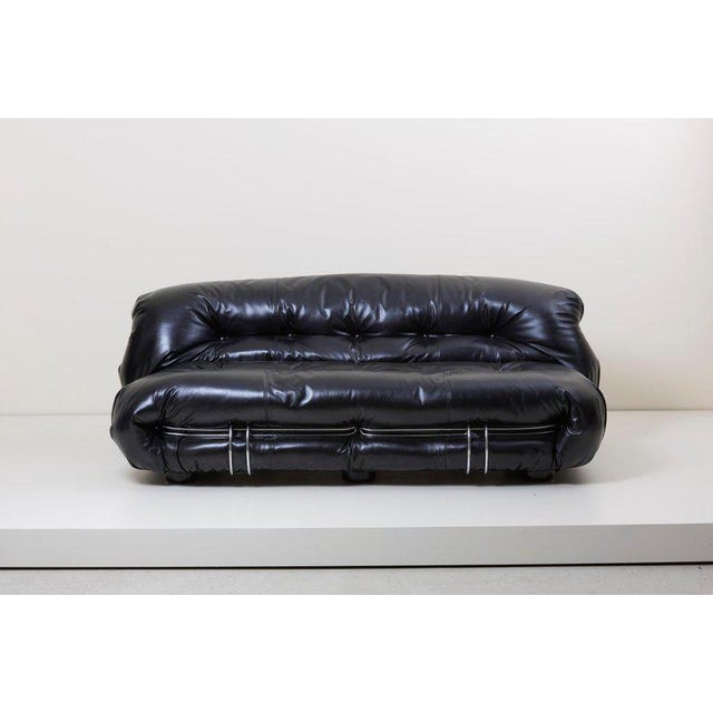 New upholstered Soriana sofa two-seat in high quality black leather by Cassina.