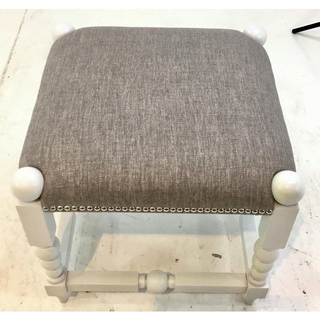 Stylish Transitional White and Gray Julianne Ottoman, white wood frame, upholstered in a gray designer fabric, chrome...
