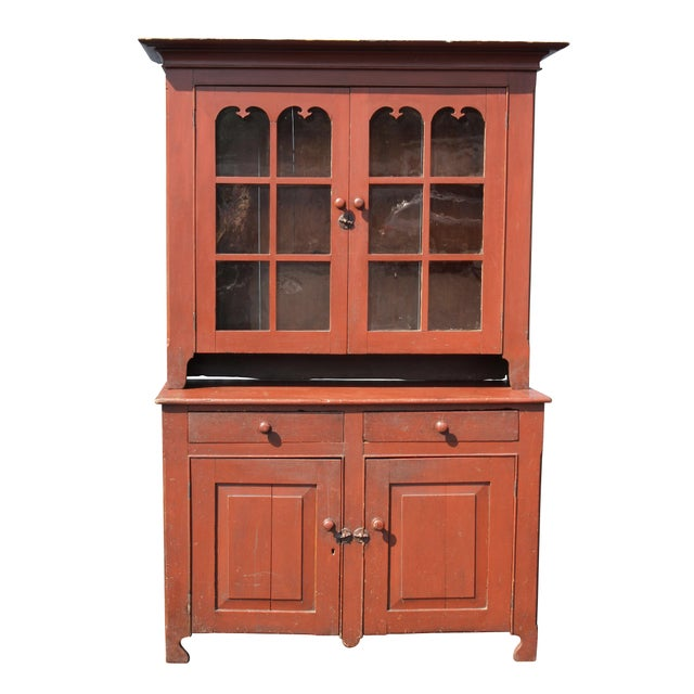 Probably Pennsylvania. Top section with cornice over a pair of glazed doors opening to shelves, the base with two drawers...