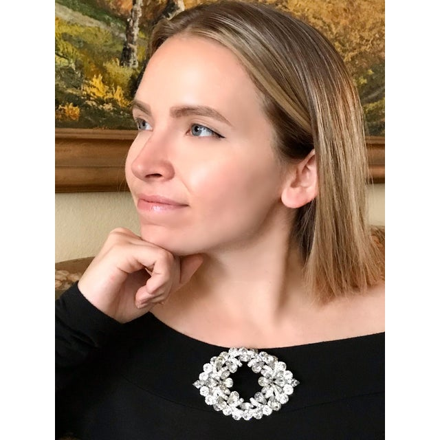 Circa 1960s Eisenberg rhodium-plated statement piece, prong set with large round, marquis and pear-shape faceted stones....