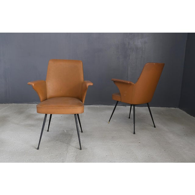 Pair of chairs by Nino Zoncada from 1950. the chairs are made of brown leather and iron structure. in the iron structure...