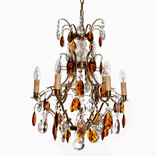 The crystal chandelier Elektra is rustic with well-balanced proportions and electric lights in its arms. The chandelier is...
