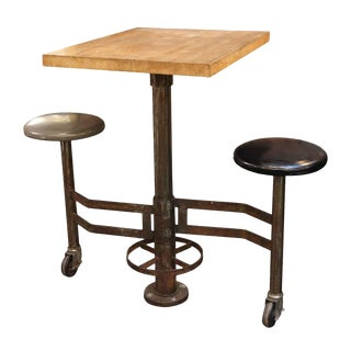 Industrial Wall Mounted Counter Height Table With Attached Rolling Stools For Sale