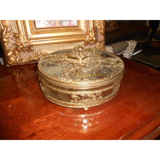 This beauty is an ornate brass ormolu jewelry casket trinket box or serving dish. The glass is heavy and the dish has a...