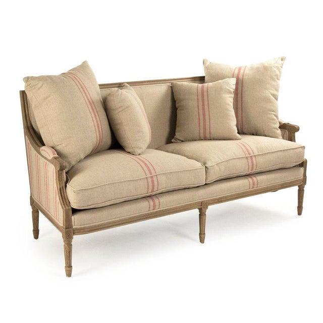 Louis sofa upholstered in khaki linen with red stripes on reclaimed oak frame.