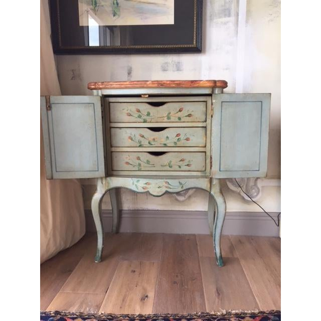 This beautiful vintage chest is handmade and hand painted by a high end company, Patina, Inc. Features 3 interior drawers...