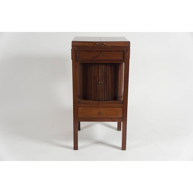 An elegant and unusual English George III period mahogany stand of rare form having 'butterfly' top revealing interior...