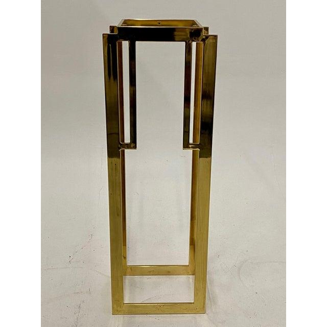 Sleek Mid-Century Modern patinated brass and glass pedestal having chic geometric design.