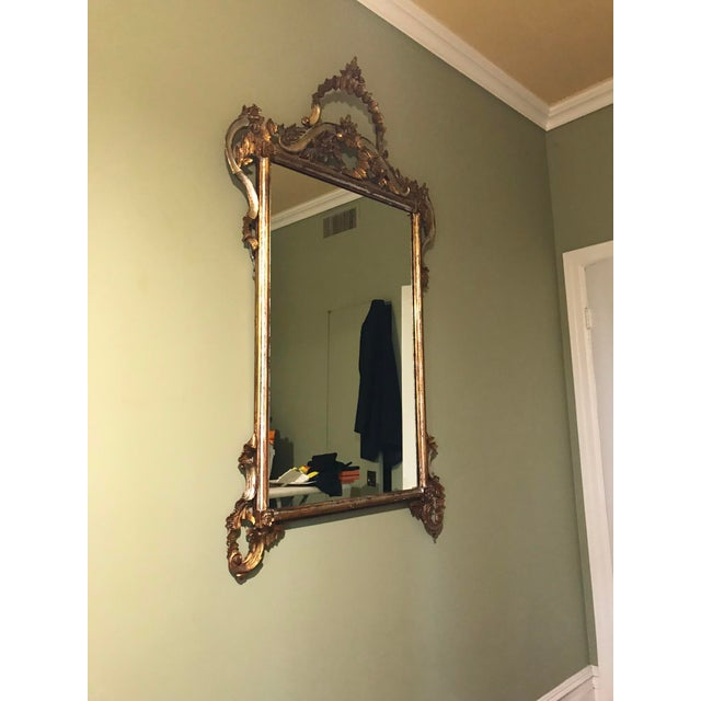 Gold leaf mirror. Probably from early 1900's. Bought in Antique shop in Argentina. Rectangular mirror but with beautiful...