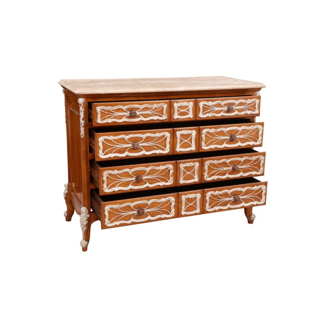 Richly carved French dresser with a German marble top. Made by Ferguson Copeland.The frame is made of European fruitwood...