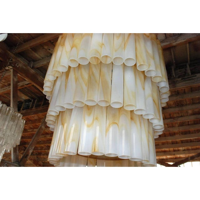 Vintage Italian chandelier with cream and caramel Murano glass tubes hand blown to produce a marbled effect, mounted on...