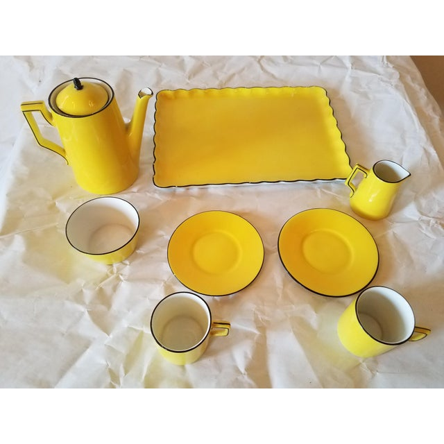 Antique miniature tea set for two. There are eight pieces in the set. We liked the bright yellow and the black trim. The...