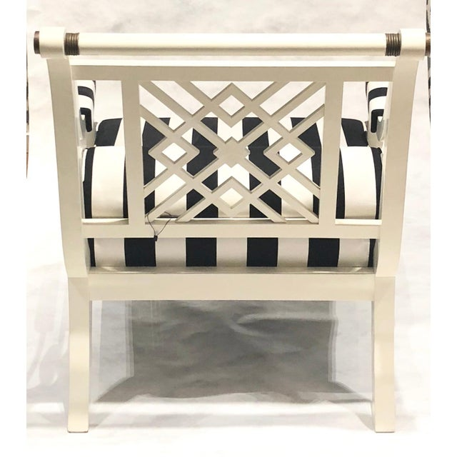 Maison Jansen white laquered wood painted armchairs. Metal hardware, circa 1960s with black and white upholstery, some...