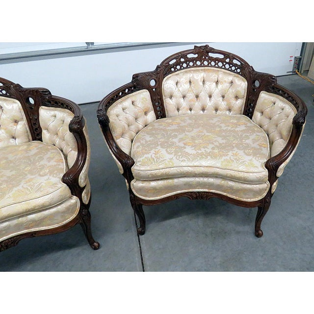 Pair of Louis XV style marquis with textured upholstery and tufted backs and sides.