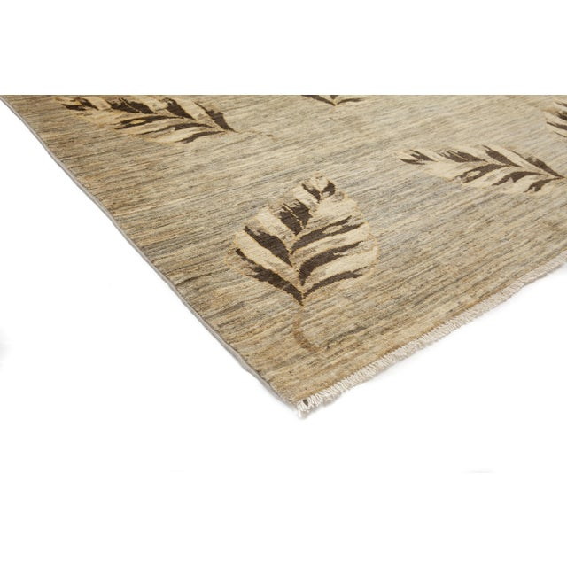 A new transitional style hand knotted rug. The tradition of hand-knotting rugs has been passed from generation to...