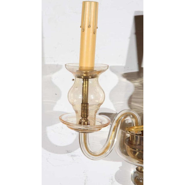 This pair of handblown Murano glass and brass sconces are a fine example of the timeless quality of Italian glasswork and...