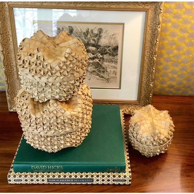 Vintage set of 3 handwoven, graduated size lidded baskets. They fit together to form what looks pineapple-like. The lid...
