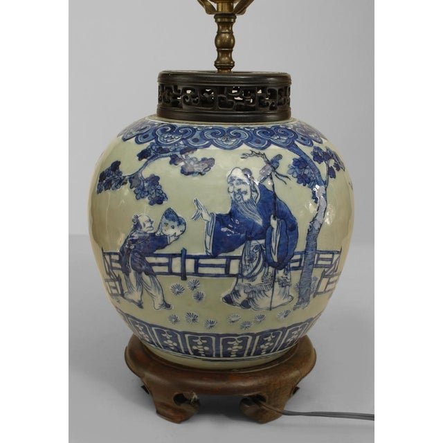 Asian Chinese style (19th Cent) celadon porcelain lamp with blue figural scene and mounted on a round teak base and...