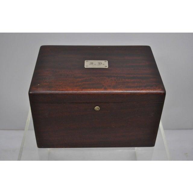 Item features silver plaque with monogram, milk glass lined interior, original finish, original filter, solid wood...