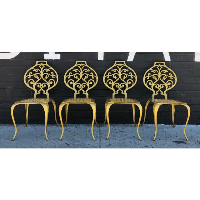 An absolutely stunning set of 4 Thinline dining chairs. The chairs have a solid aluminum body and feature a gorgeous fleur...