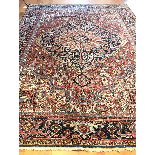 This antique Persian Heriz rug is truly one of a kind. It will match beautifully with a variety of decor schemes!