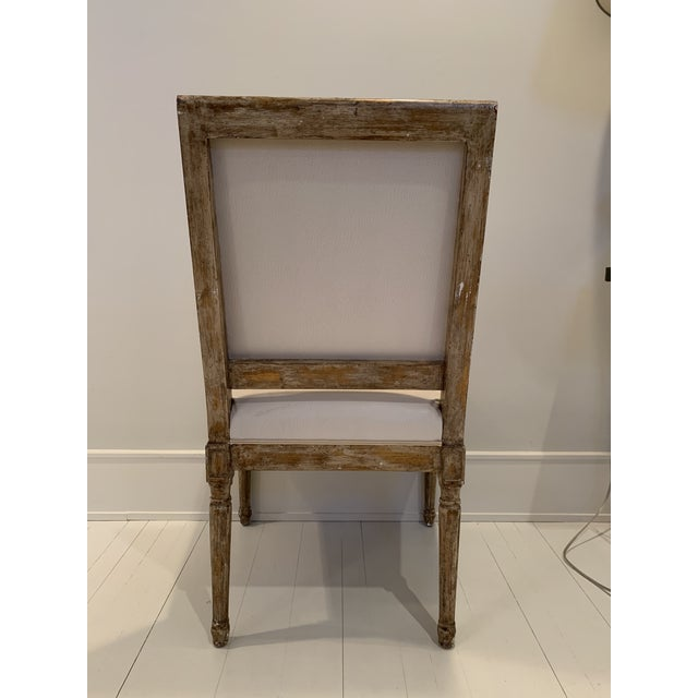 Nice single chair upholstered in faux cream colored ostrich leather