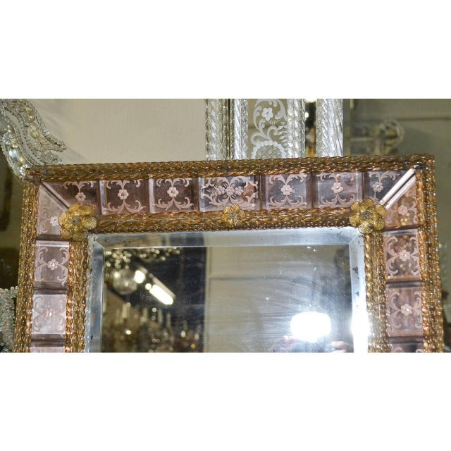 Gorgeous pink handmade Italian Venetian etched mirror. The bottom pegs can be easily removed, circa 1920.