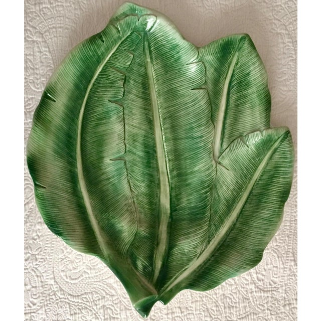 This fabulous large Italian ceramic had-painted platter is in the shape of banana leaves and would make a dramatic...
