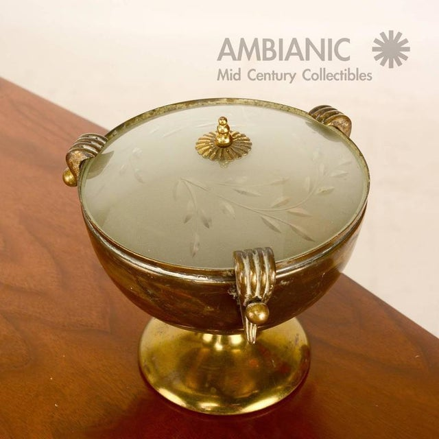 For your consideration a table lamp in the shape of an urn. Brass body with original glass shade in frost finish and...