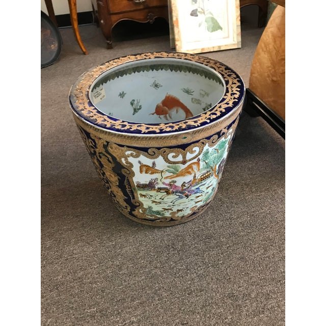 The Chinese cobalt porcelain fishbowl with figural hunt scene on the exterior and a fish motif to the interior. These...