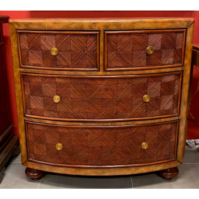 Leather-covered chest of drawers with pencil reed drawer fronts made by Lineage. The design is in the style of Maitland-...