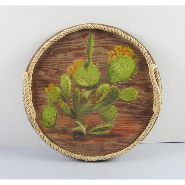 Vintage round tray with rope edge and handles. Hand painted cactus on wood.