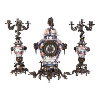 French Japonisme Parcel-Gilt Patinated Bronze Imari Porcelain Clock Garniture - Set of 3 For Sale