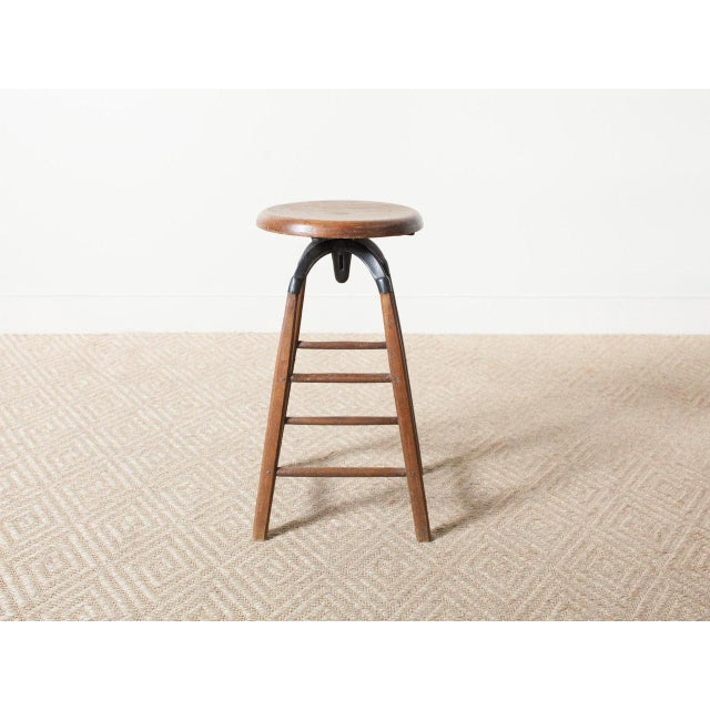 Vintage wooden stool with adjustable seat height France Circa 1880