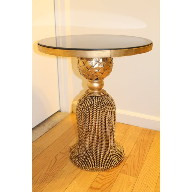 Ebony stone topped gold tassel table that makes a statement in any room. Table top is 20 inches in diameter and the table...