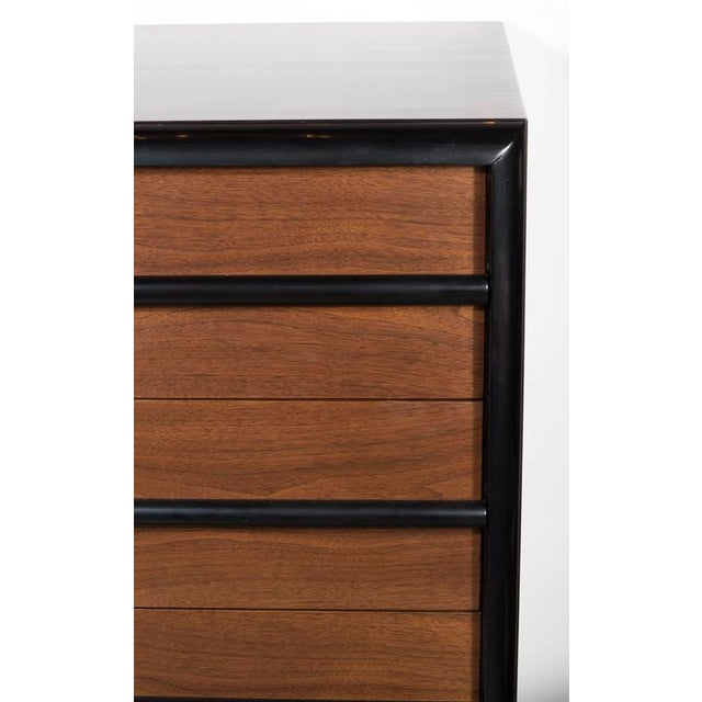 A sophisticated Mid-Century Modernist four-drawer high chest by Robsjohn-Gibbings for Widdicomb Company in hard rubbed...