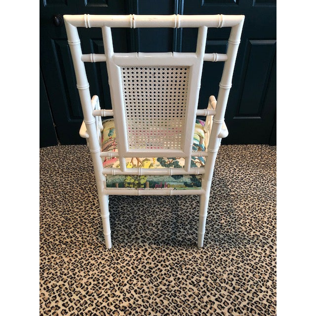 Fun and cheery Chinese Chippendale Chair finished in white lacquer. Cane back insert. Seat has been reupholstered in...
