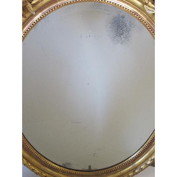 A Finely-Carved French Napoleon III Oval Giltwood Mirror with Shell Crest and Floral Garland For Sale - Image 4 of 5