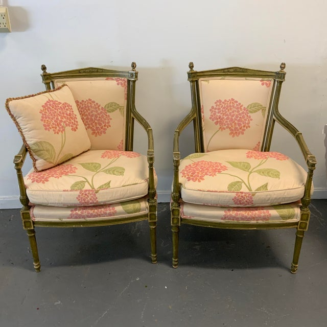 Pair of Italian Upholstered Arm Chairs. Silk embroidered fabric with pink and orange hydrangeas motif. Wood frame painted...