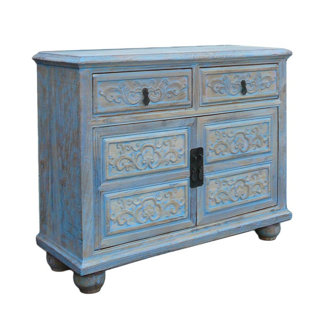 This is a solid, elm wood cabinet , high credenza with relief floral carving motif at the front. It is finished with...
