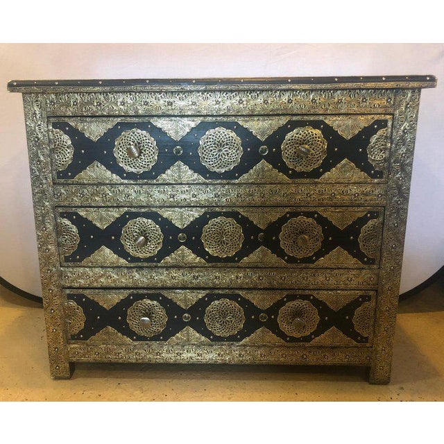 Pair of brass and ebony natural stone and leather inlaid Moroccan commode, chests or nightstands. These exceptional chests...