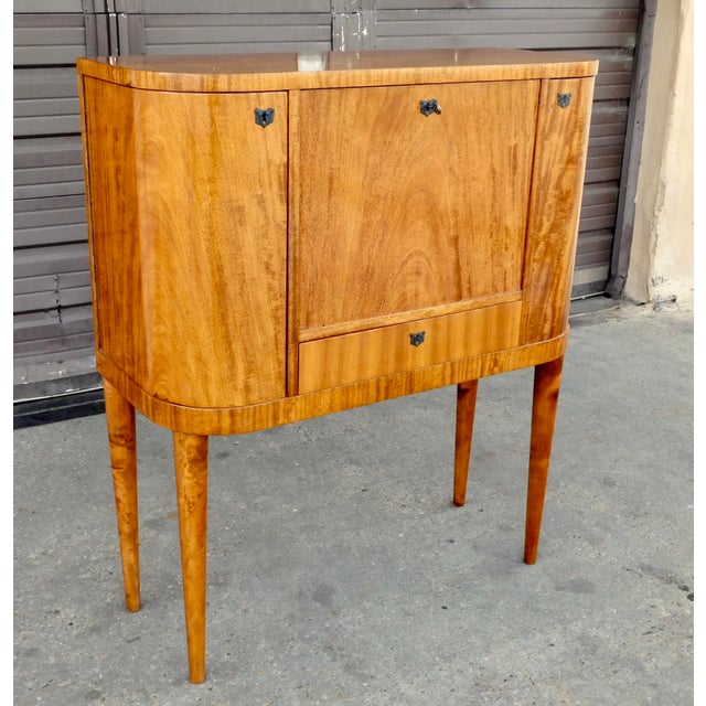 Swedish Art Moderne drop front secretary desk with side cabinets for bottle storage. Rendered in open grain, natural color...