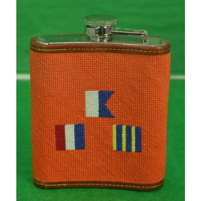 A needlepoint flask featuring 3 signal flags. Flask holds 6 ounces.